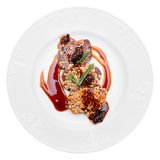 Venison fillet fried with pine nuts, isolated Royalty Free Stock Photos