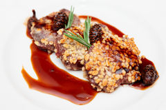 Venison fillet fried with pine nuts in plate Royalty Free Stock Image