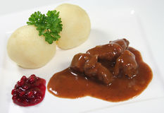 Venison goulash. With dumplings and cranberries royalty free stock photos