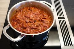 Venison goulash with paprika and onions in a cooking pot Stock Images