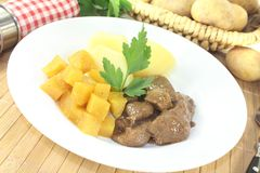 Venison goulash with rutabaga and parsley Royalty Free Stock Photography