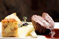 Venison meat steak with Quiche pie Stock Photos