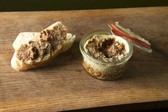 Venison pate with bread on wooden board Royalty Free Stock Images