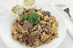 Venison Pilaf and Roasted Garlic Cloves Royalty Free Stock Photography