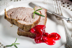 Venison served with cranberry sauce Royalty Free Stock Images