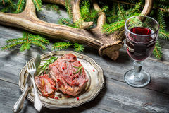 Venison served in the forester lodge with wine Stock Image