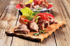 Venison souvlaki and bacon strip Royalty Free Stock Images