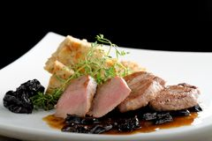 Venison steak cuts on a chestnut puree Stock Image