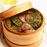 Venison steaks smoked with pine branches Stock Photo