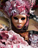 Venitian Carnival in Paris. Performers in costume gathered on a quay of the river Seine for a Venetian carnival parade in Paris, France