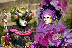 Venitian Carnival in Paris. Performers in costume gathered on a quay of the river Seine for a Venetian carnival parade in Paris, France Stock Image