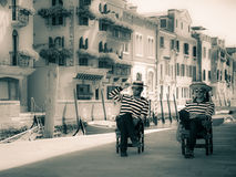 Venitian chat. Gondoliers chatting and waiting for clients in Venice Royalty Free Stock Image