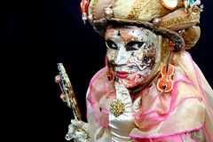 A venitian masked lady. Portrait of a masked lady in venice royalty free stock photo