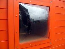 Venster in sinaasappel Stock Afbeeldingen