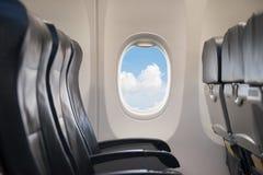 Venster in vliegtuig Royalty-vrije Stock Foto
