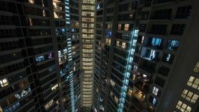 Vensterlichten in huis met meerdere verdiepingen bij nacht, Kuala Lumpur Royalty-vrije Stock Afbeelding