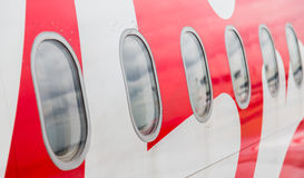 Vensters van vliegtuig stock afbeelding