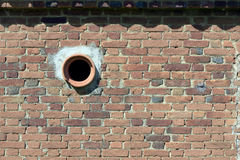 Vent in brick wall of antique barn Stock Image