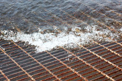 Vent grid flooded with water Royalty Free Stock Images