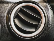 Vent inside the car. Grille of the air conditioner and heating. stock images