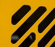 Vent slits in the body of yellow road machinery close-up royalty free stock photos