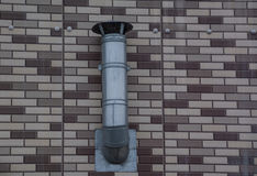 Vent system hanging on the brick wall Stock Photography