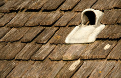 A vent on a traditional wooden roof. Royalty Free Stock Image