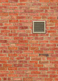 Vent on Weathered Brown Brick Wall, Vertical Pattern. Vent on Weathered Brown Brick Wall of Old Building, Vertical Pattern Royalty Free Stock Photography