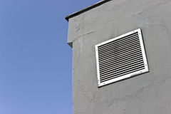 Vent window on gray concrete wall Stock Photography