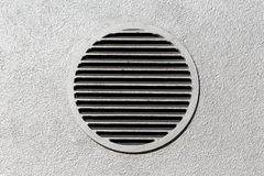 Vent window on gray concrete wall Royalty Free Stock Images