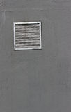 Vent window on gray  wall Stock Images
