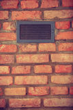 Vent window on red brick wall Royalty Free Stock Image