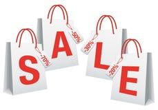 Venta, bolsos de compras blancos,   Imagenes de archivo