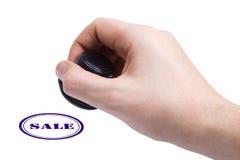 Venta de la mano y del sello de goma Imagen de archivo libre de regalías