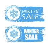 Venta del invierno con el copo de nieve en banderas dibujadas azules Imágenes de archivo libres de regalías
