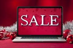 Venta en línea de la Navidad del ordenador Foto de archivo libre de regalías