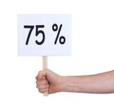 Venta - mano que lleva a cabo el suspiro que dice el 75% Imágenes de archivo libres de regalías