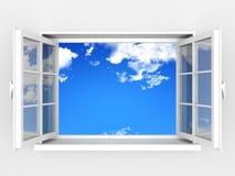Ventana abierta contra una pared blanca y un cielo nublado
