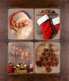 Ventana con cuatro escenas de la Navidad Imagenes de archivo