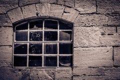 Ventana con el agujero de bala Imagen de archivo libre de regalías