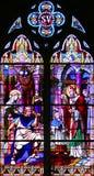 Ventana de cristal de colores religiosa Imágenes de archivo libres de regalías