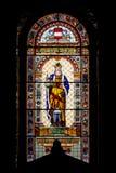 Ventana de cristal manchada de la iglesia católica Imagen de archivo libre de regalías