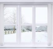 Ventana de la escena de la nieve Imágenes de archivo libres de regalías