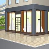 Ventana de la tienda con los vestidos de boda Imagen de archivo libre de regalías