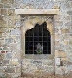 Ventana de piedra con las barras Imagen de archivo libre de regalías