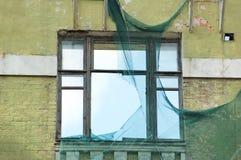 Ventana del edificio abandonado Foto de archivo libre de regalías