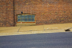Ventana del sótano del bloque de cristal Imagen de archivo libre de regalías