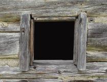 Ventana en una cabaña de madera vieja Imágenes de archivo libres de regalías