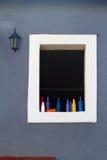 Ventana en una pared del yeso Fotografía de archivo libre de regalías