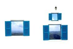 Ventana griega del estilo con la opini?n de la monta?a y del cielo Foto de archivo libre de regalías